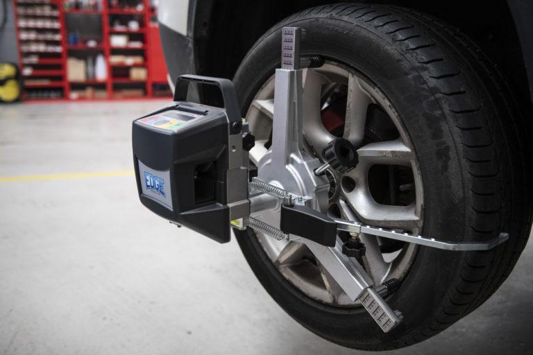 Wheel Alignment machine attached to wheel