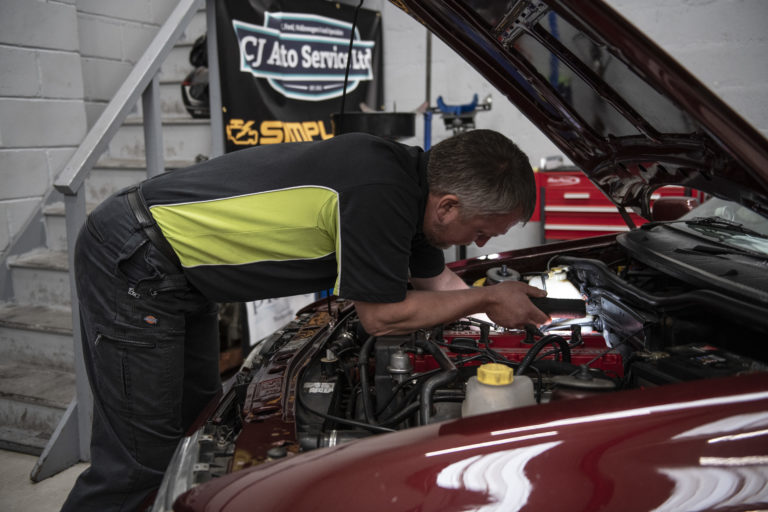 Fixing Old Maroon Ford as part of Servicing