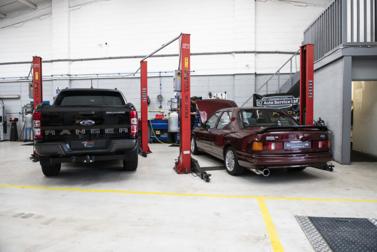 Two fords in the garage